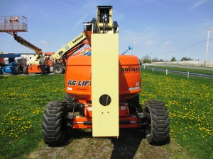 What does an oscillating axle do in a aerial lift?
